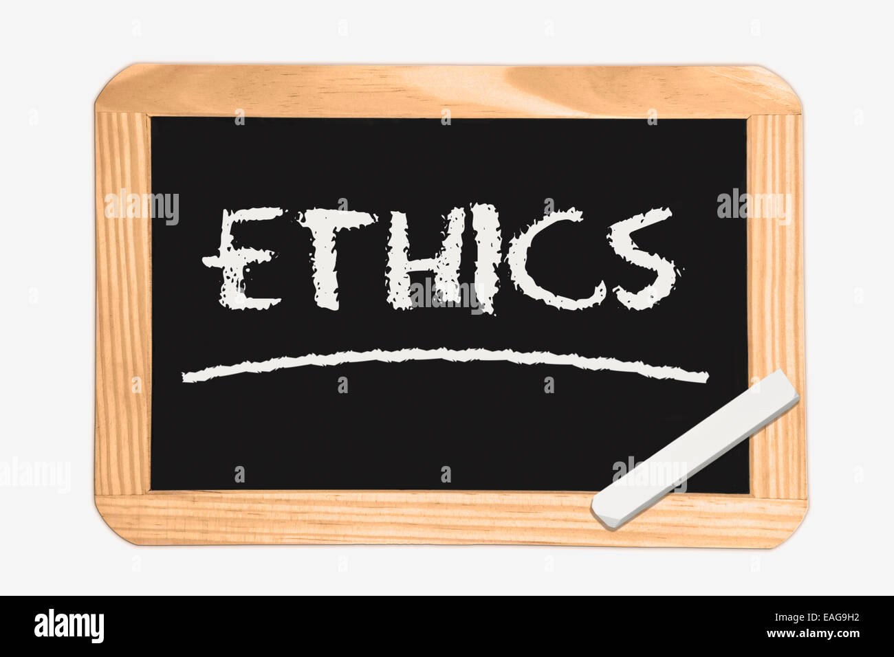Blackboard with the inscription Ethics, a piece of white chalk in the corner - Stock Image