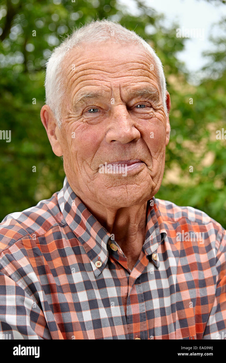 Elderly man with checked shirt - Stock Image
