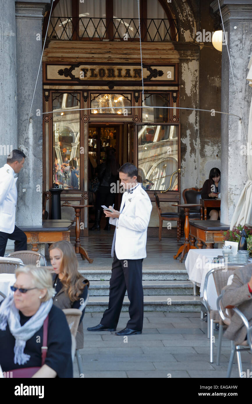 Waiters and customers outside the Caffe Florian, Venice, Italy. - Stock Image