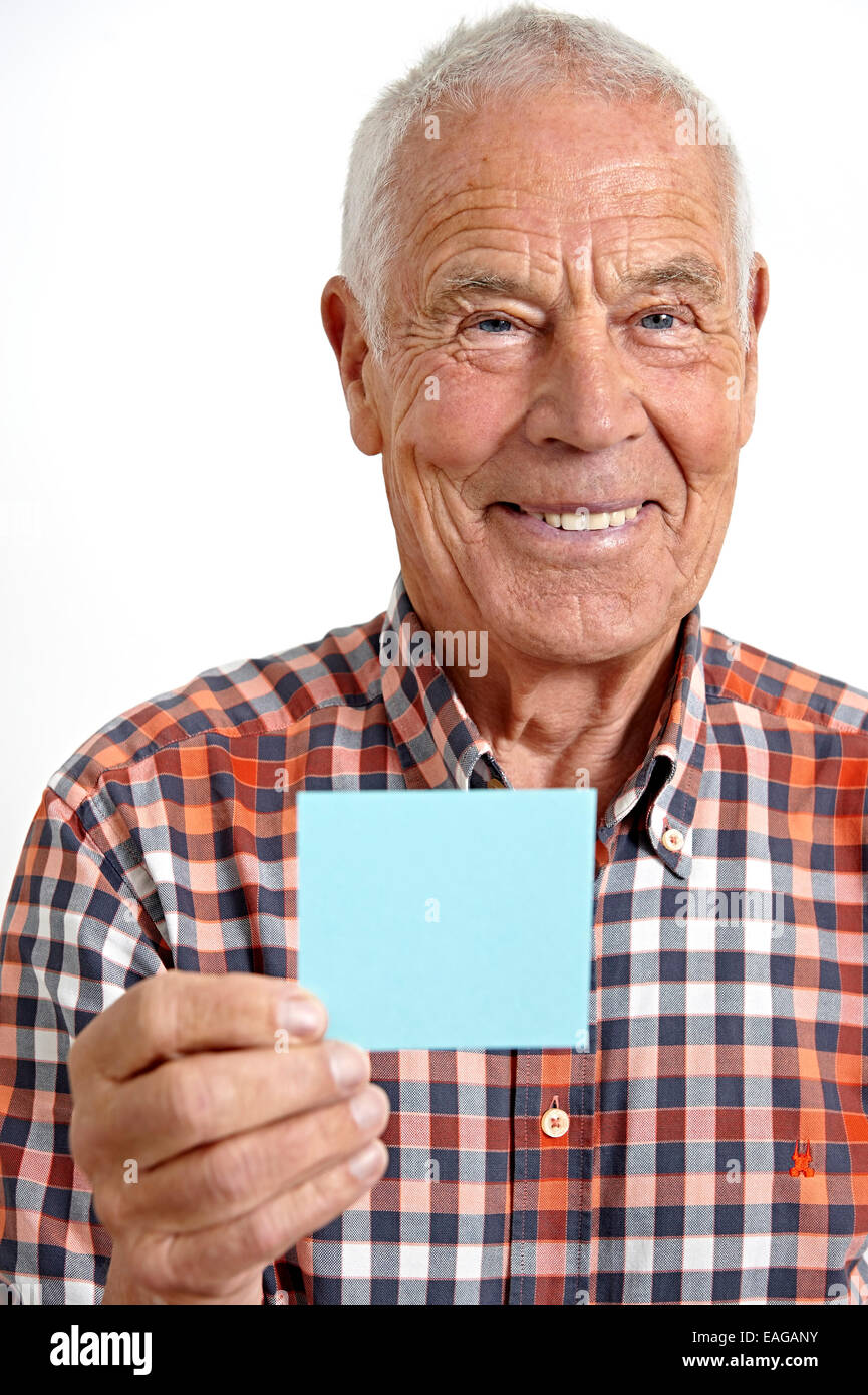 Senior with a notepad - Stock Image