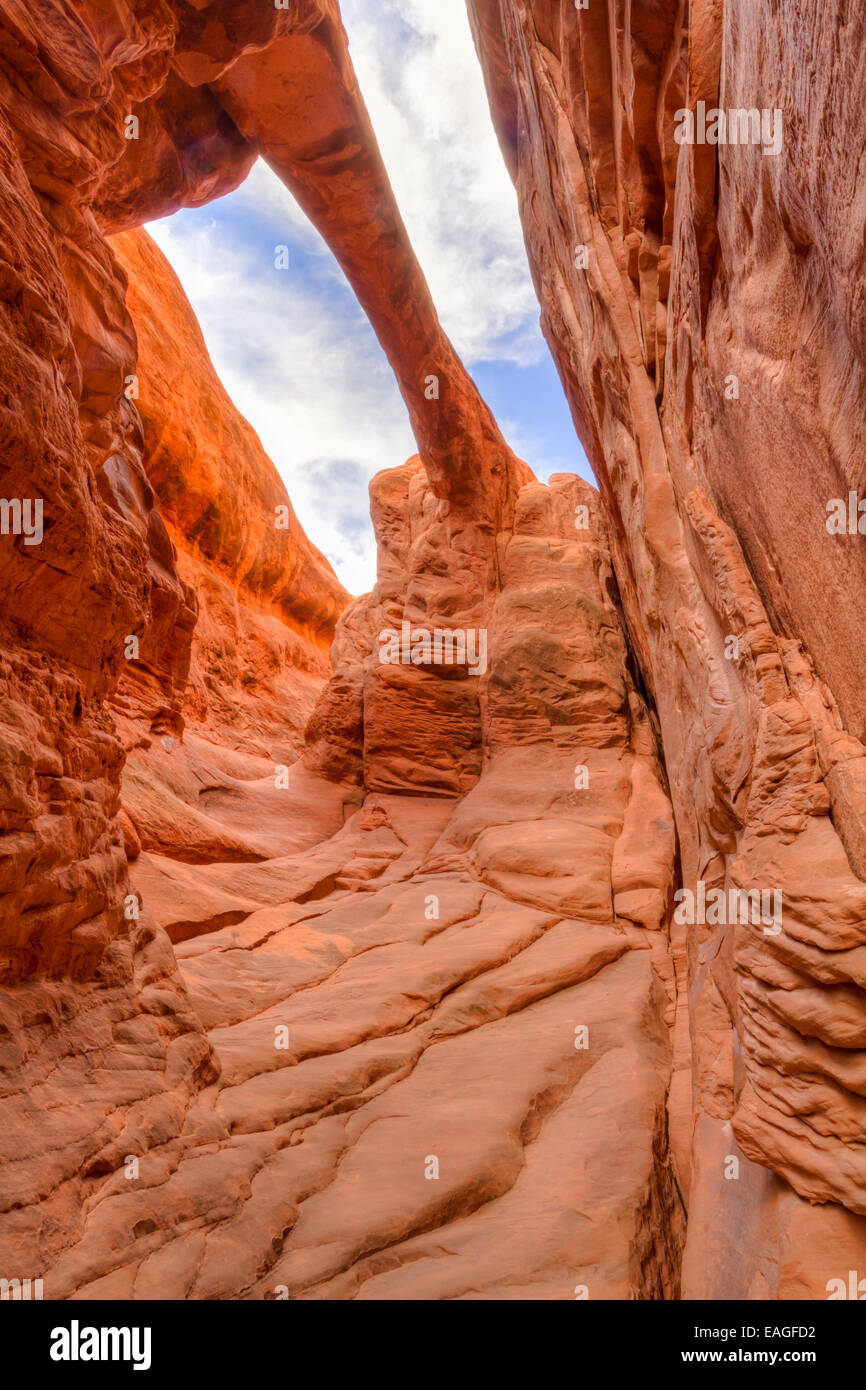 Looking up at Surprise Arch in the Fiery Furnace section of Arches National Park in Utah. - Stock Image