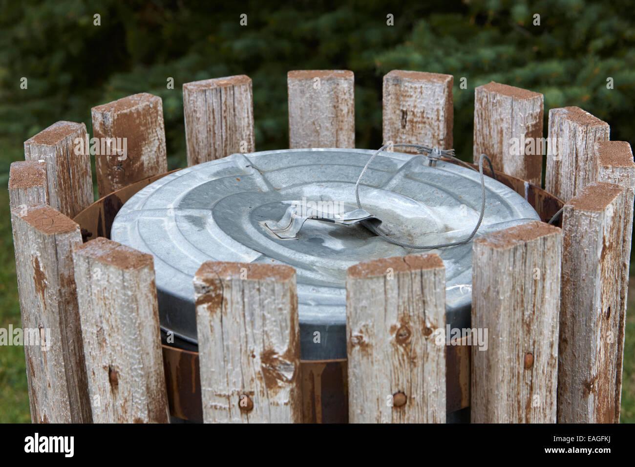 metal public garbage bin with wire lid strapSaskatchewan Canada - Stock Image