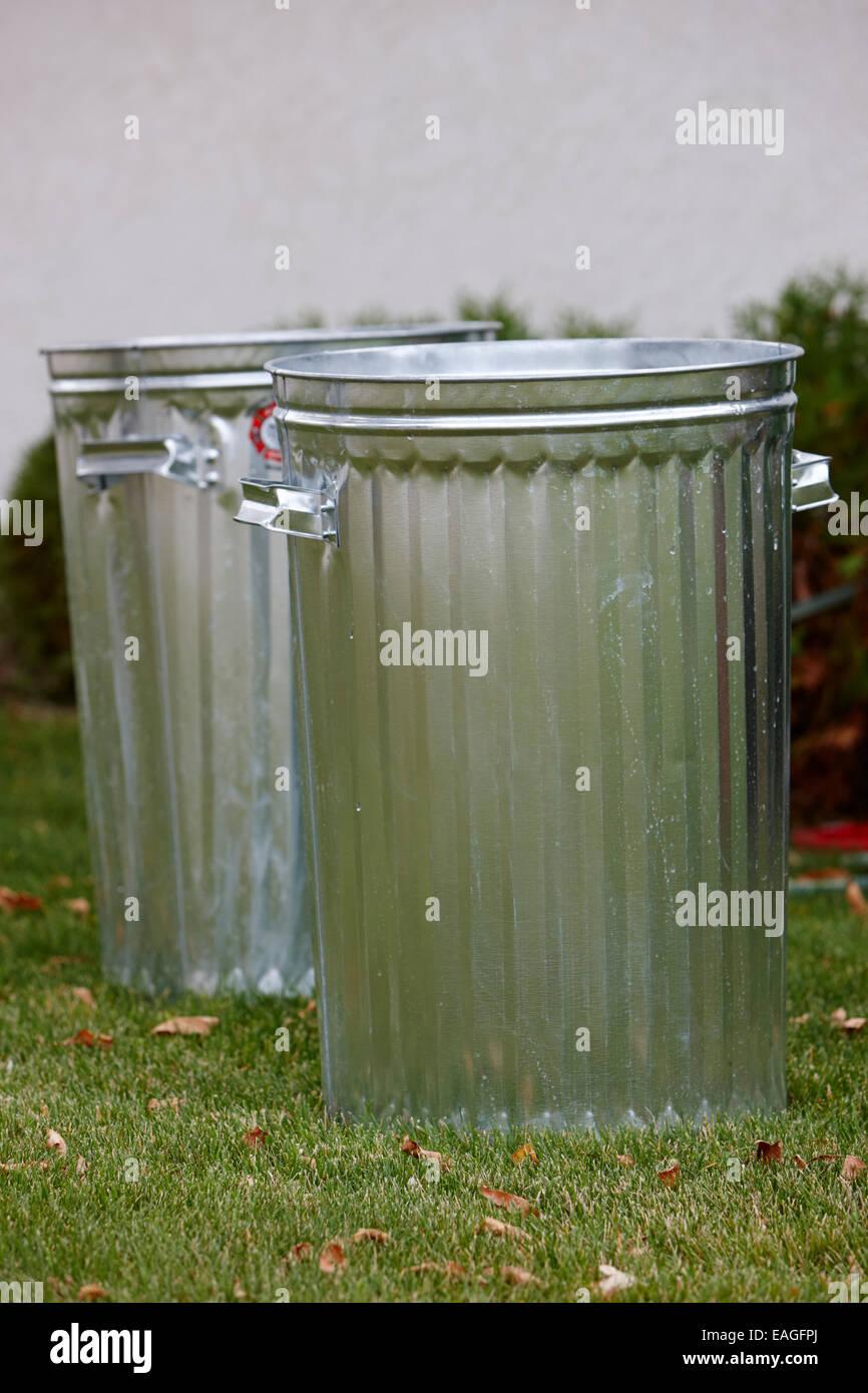 new metal garbage bins on lawn Saskatchewan Canada - Stock Image