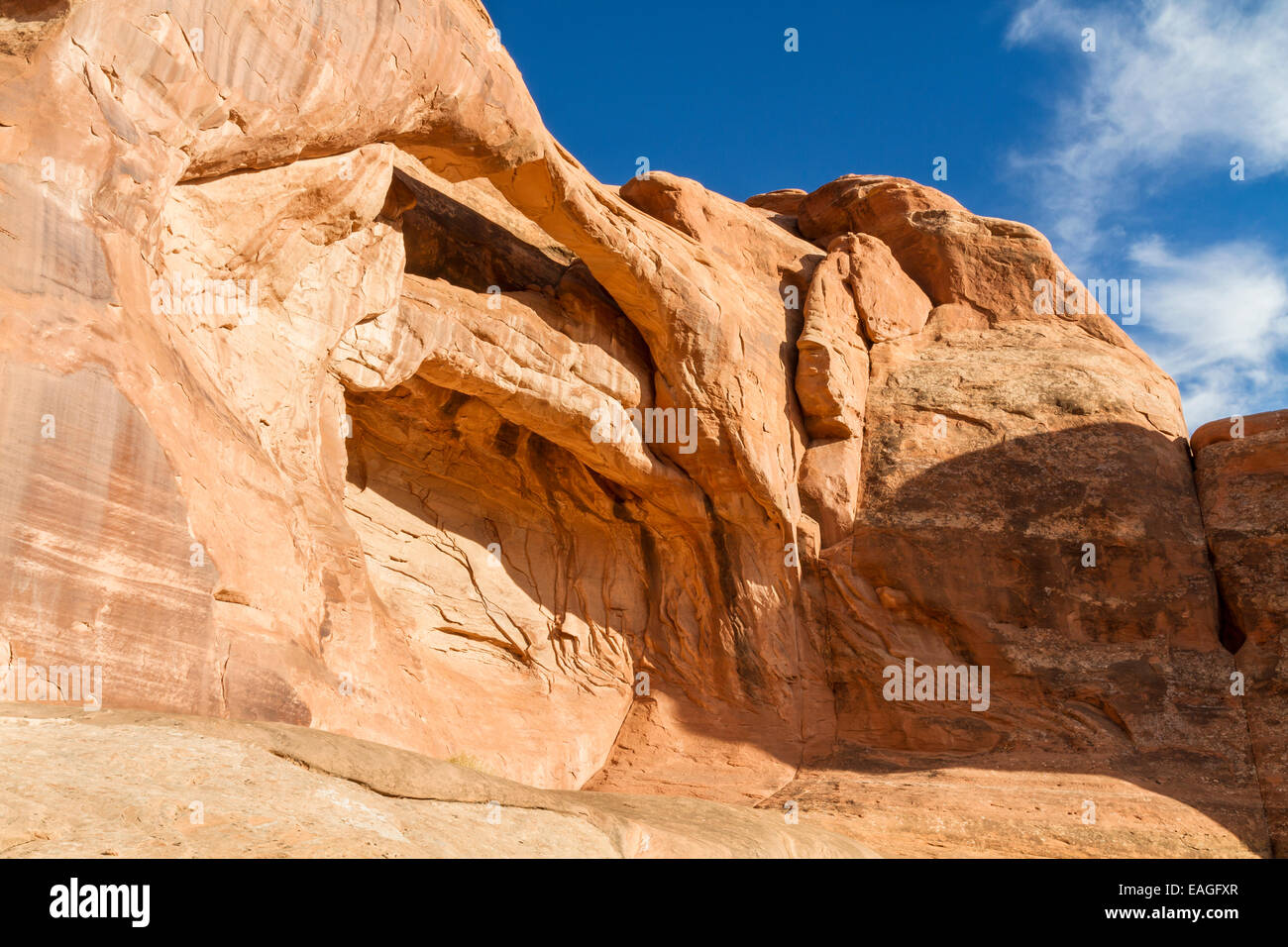 A layered arch near Tower Arch in the Klondike Bluffs area of Arches National Park, Utah. - Stock Image