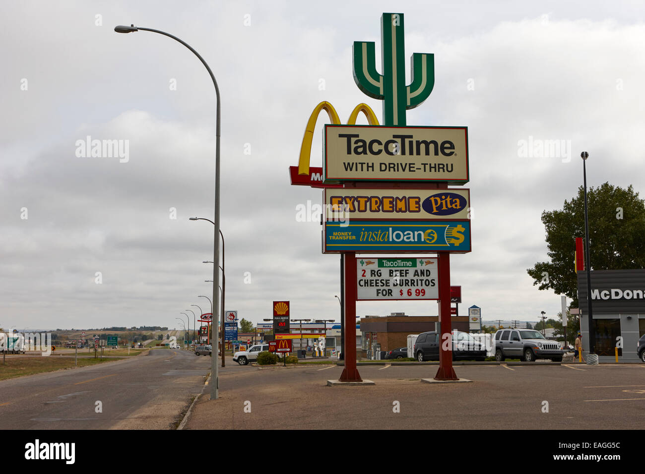 highway access road restaurant and hotel adverts signs swift current Saskatchewan Canada - Stock Image