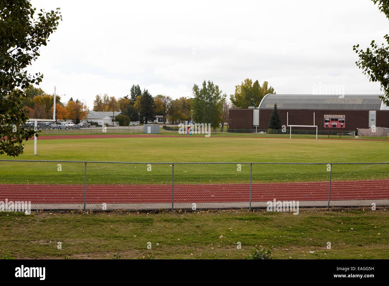 high school running track and football field swift current Saskatchewan Canada - Stock Image