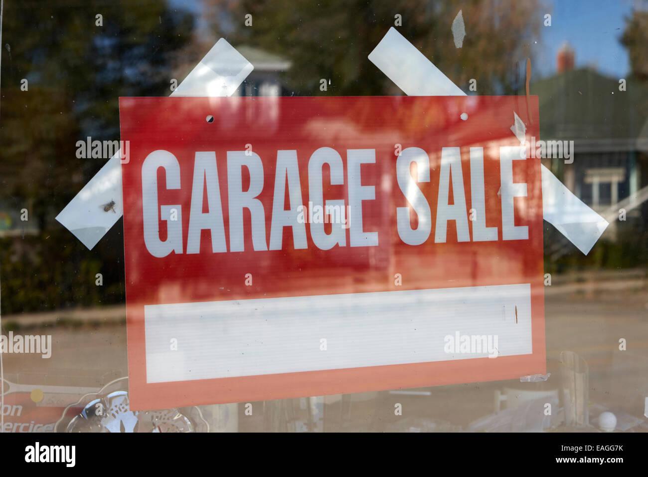 garage sale sign in a house window Saskatchewan Canada - Stock Image
