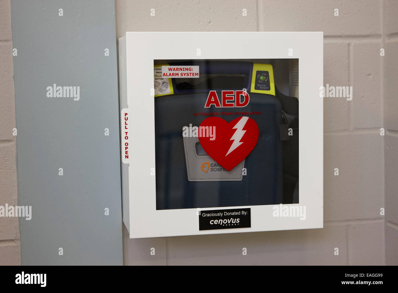 aed automated external defibrillator installed in a high school public place Saskatchewan Canada - Stock Image