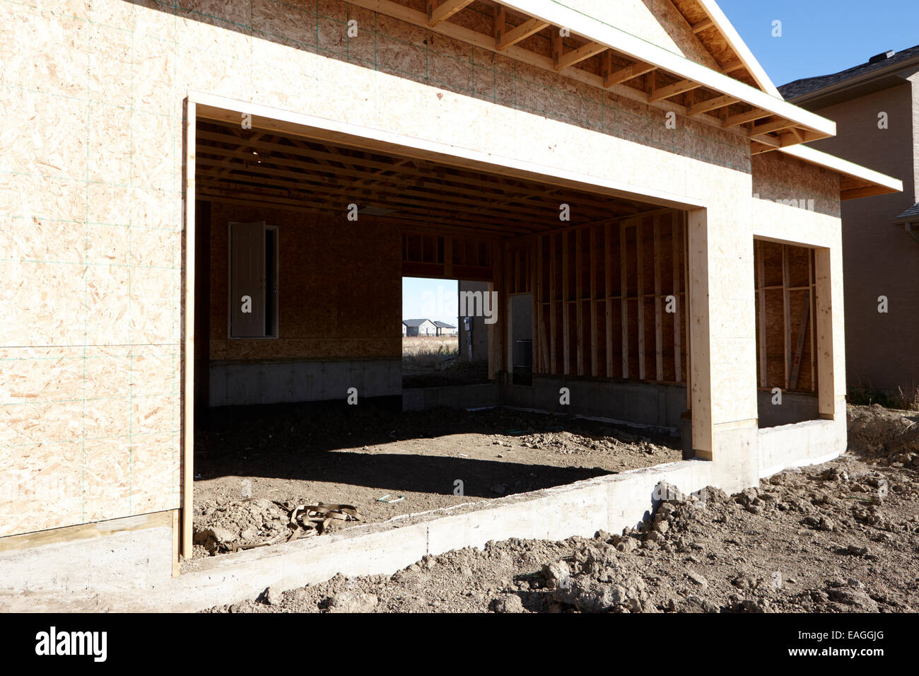 typical timber framed house garage construction with sheet panels Saskatchewan Canada - Stock Image