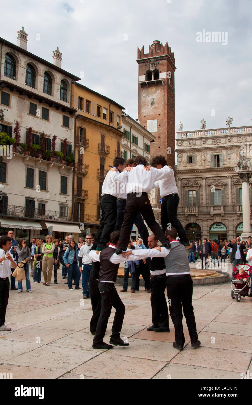 Boys Performing A Traditional Dance On The Piazza Delle Erbe, Verona, Italy - Stock Image