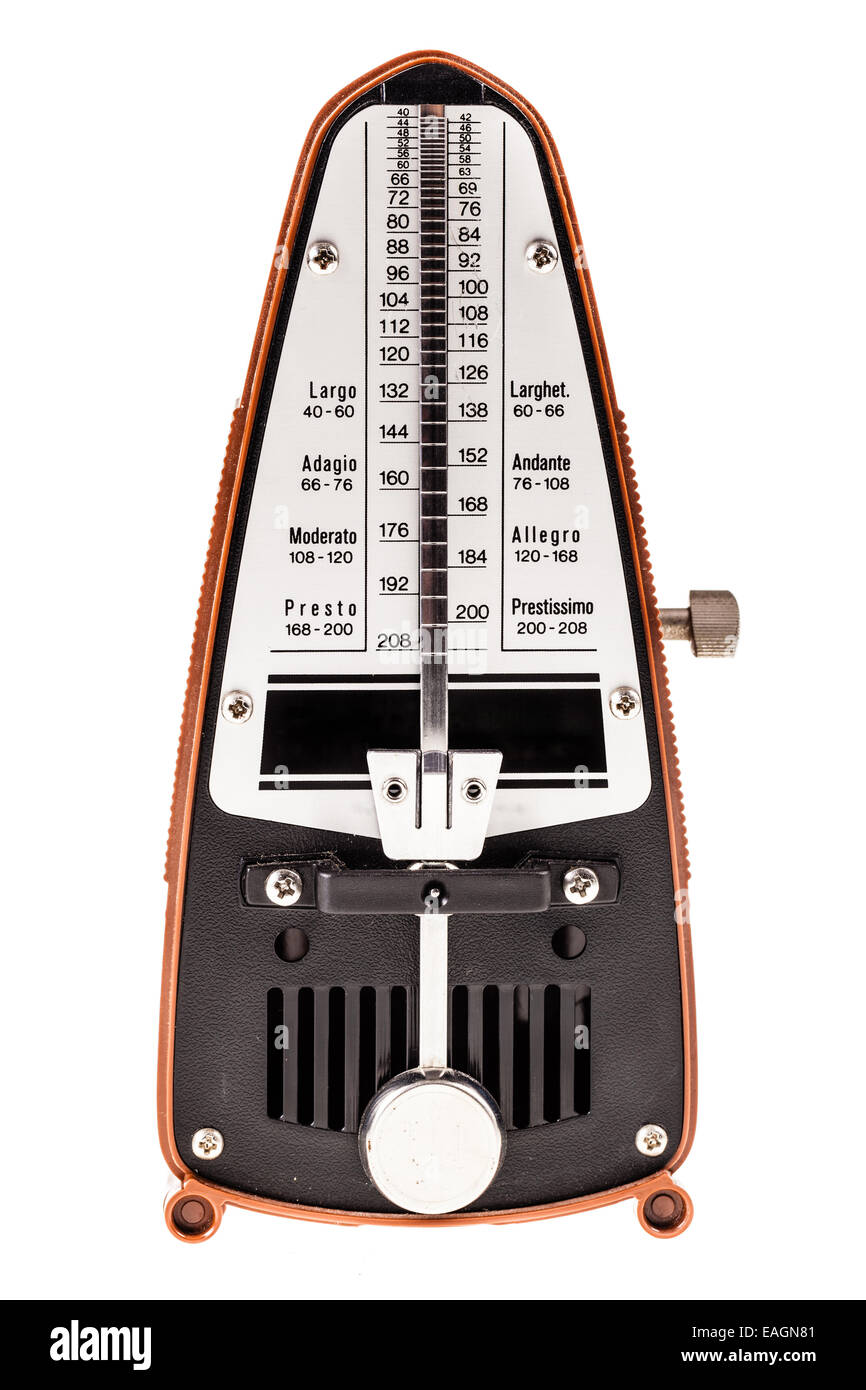 a small metronome isolated over a white background - Stock Image