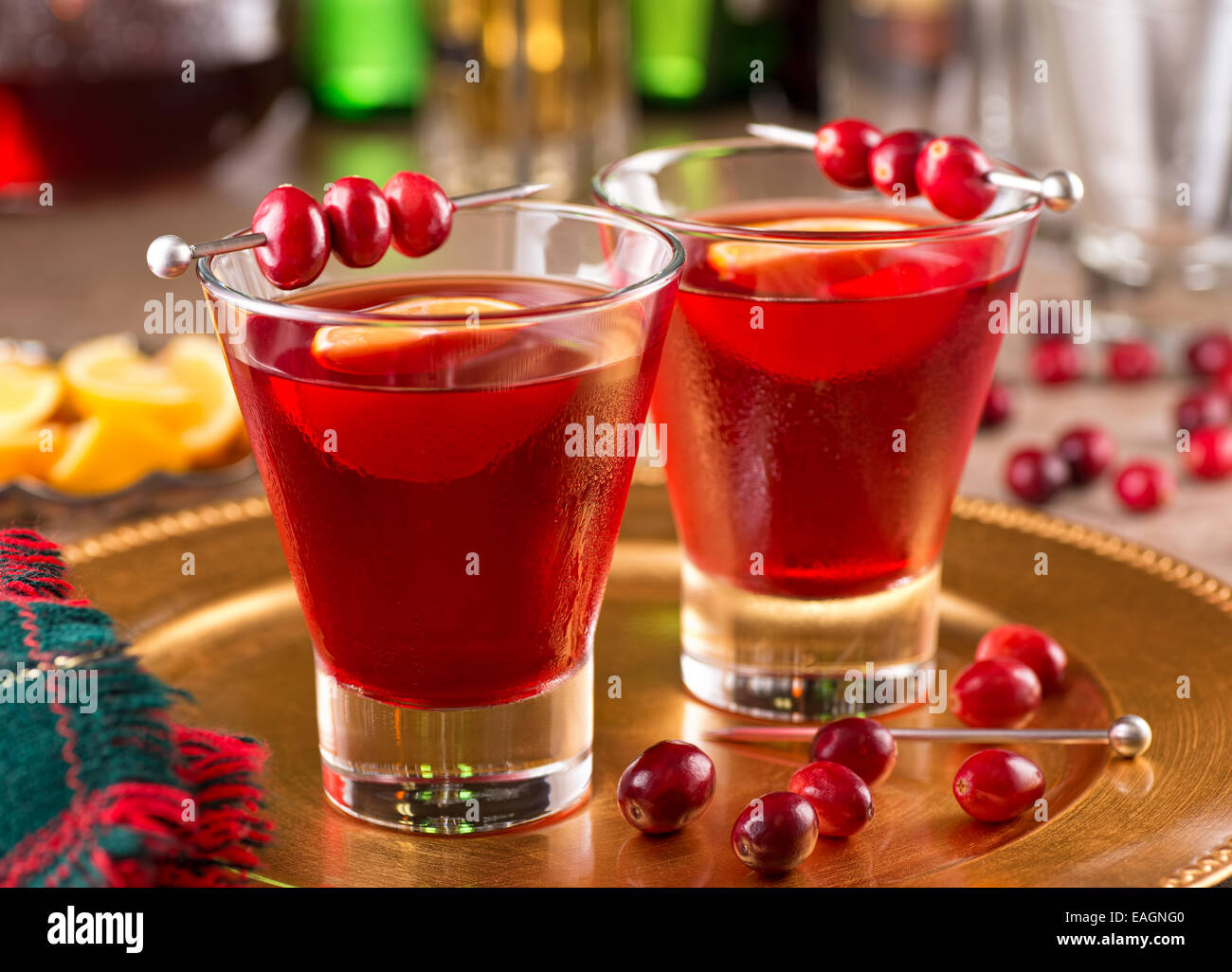 Two delicious cranberry cocktails with cranberry juice and lemon. - Stock Image