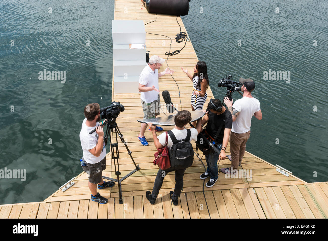 Crew member interviewed and filmed, Volvo Ocean Race 2014-2015, Cape Town, South Africa - Stock Image