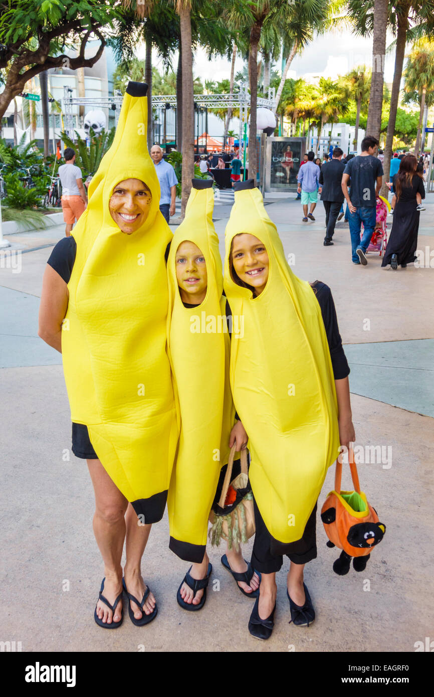 miami beach florida lincoln road pedestrian mall halloween costume wearing outfit character woman mother boy son girl daughter family bananas