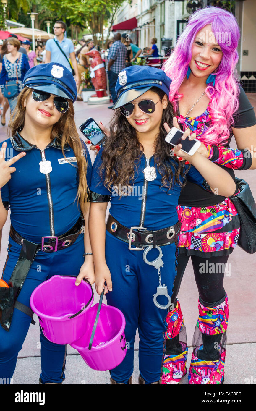 miami beach florida lincoln road pedestrian mall halloween costume wearing outfit character girl friends police uniform policewoman adolescents