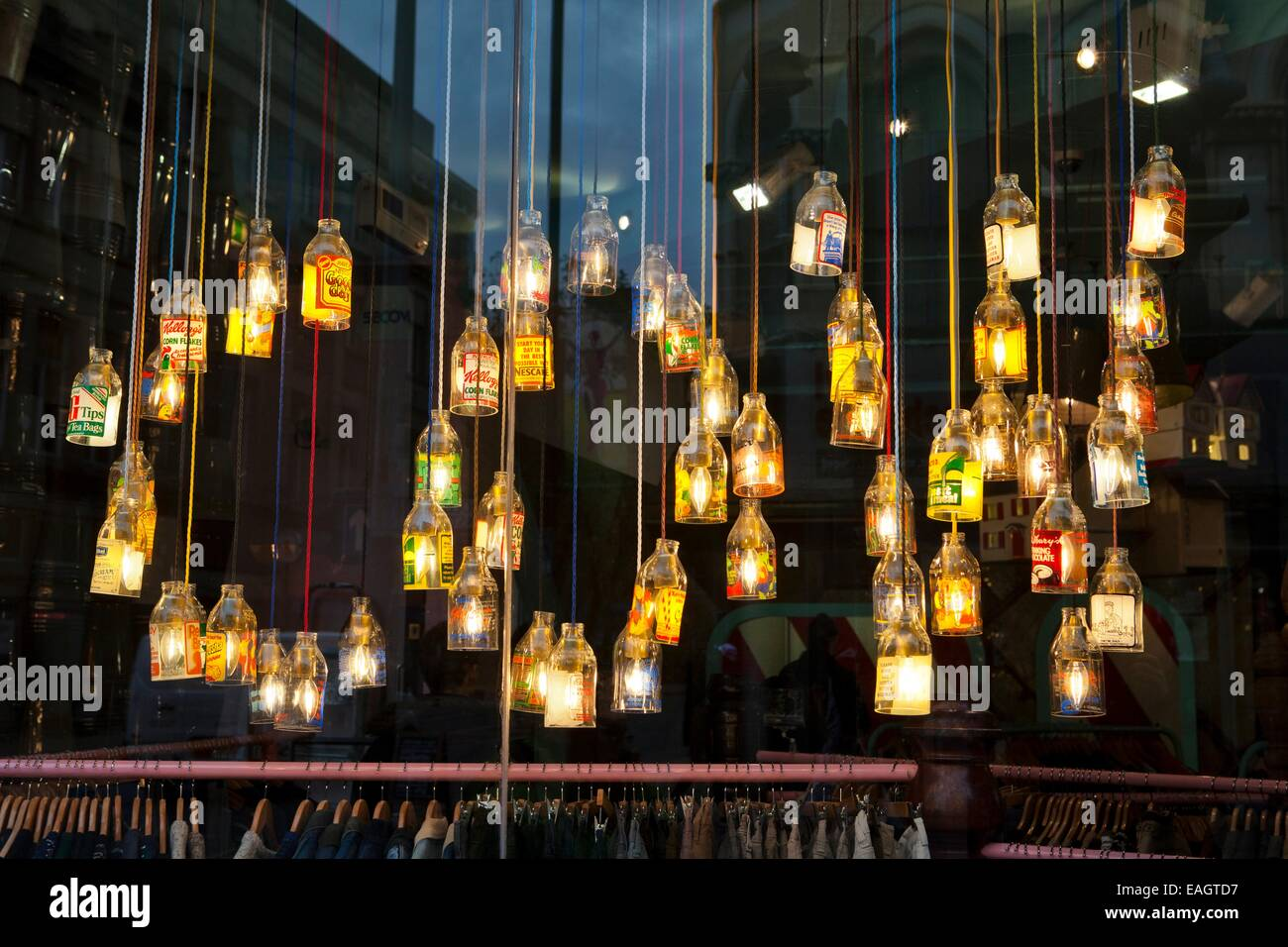 'Cow' clothing store with broken bottles as lights & lamp shades,lighting, energy, power, equipment, - Stock Image