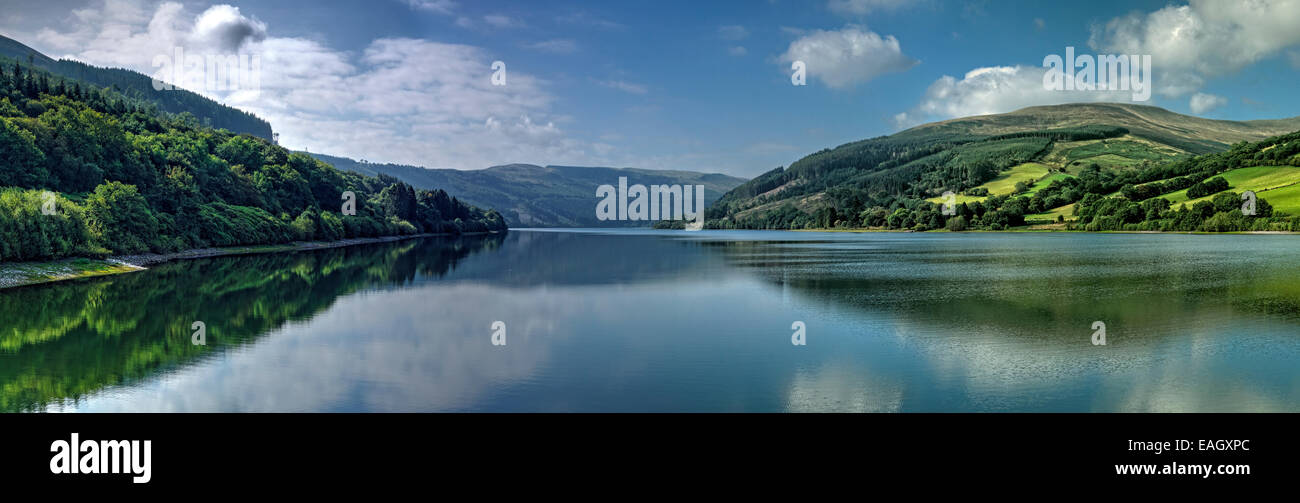 Panoramic view of Talybont Reservoir with the hills and clouds reflected in the water. - Stock Image