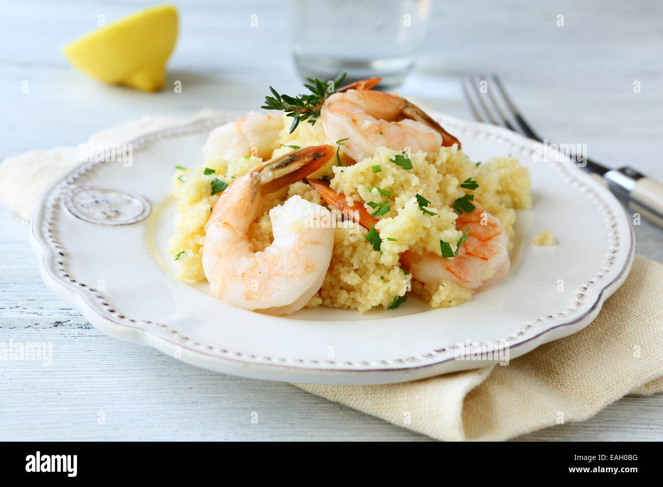 Nutritious couscous with shrimp. Seafood - Stock Image