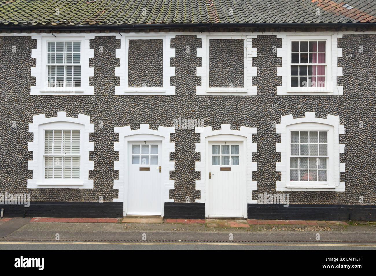 Terraced flint cottages, Albert Street, Holt, Norfolk - Stock Image