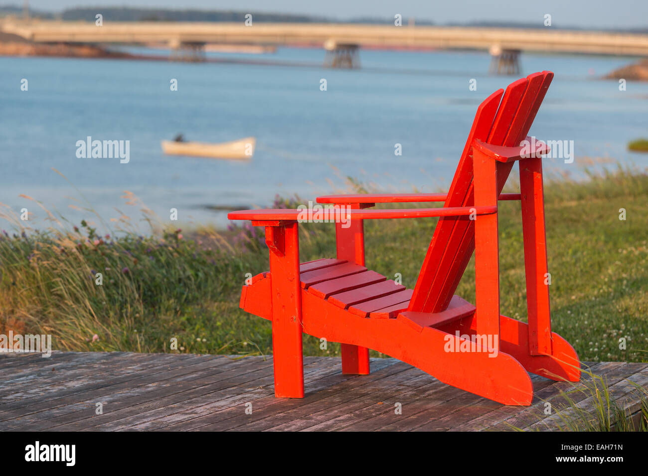 A Red Lawn Chair With A View Of A Seaside Vista In Rural Prince Edward  Island