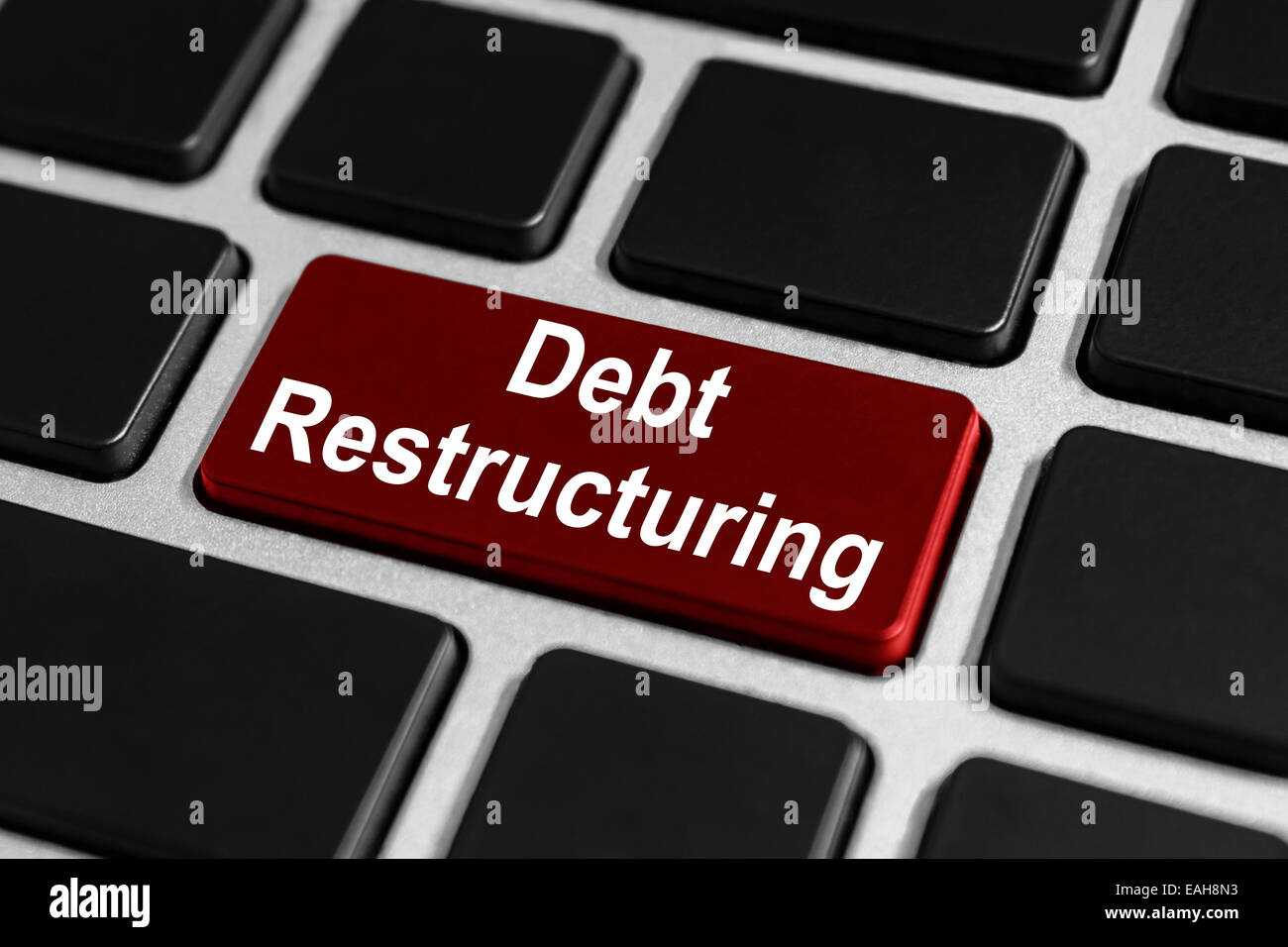 debt restructuring red button on keyboard, business concept - Stock Image