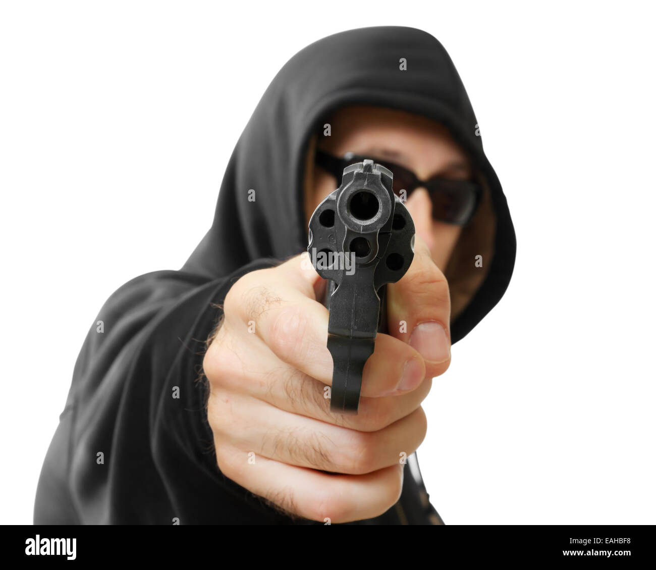 man  shoots a gun, gangster, focus on the gun, isolated on white - Stock Image