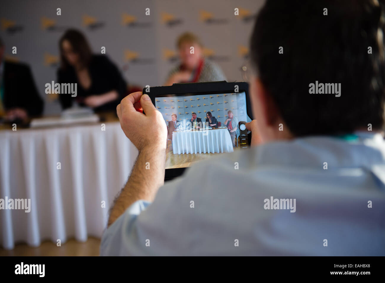 Aberystwyth, Wales, UK. 15th November, 2014. A part member makes a video of the key speakers on his iPad at the - Stock Image