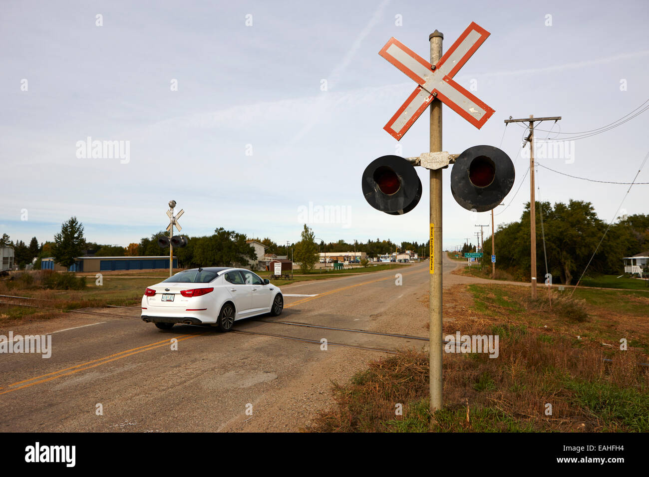 car crossing railroad level road crossing leader Saskatchewan Canada - Stock Image