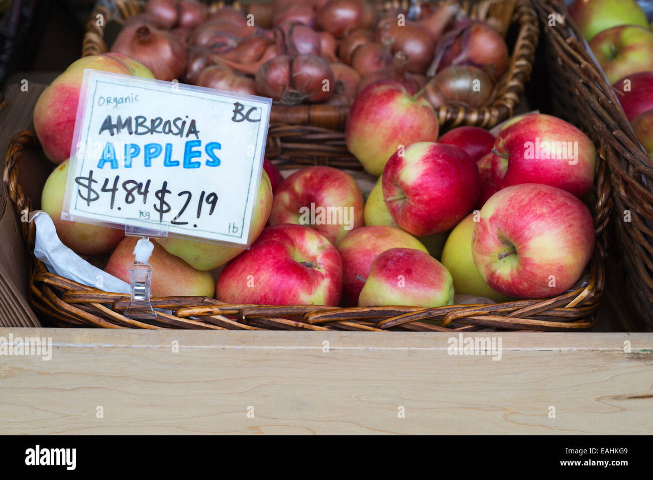 Organic Ambrosia apples grown in British Columbia for sale at Calgary market - Stock Image