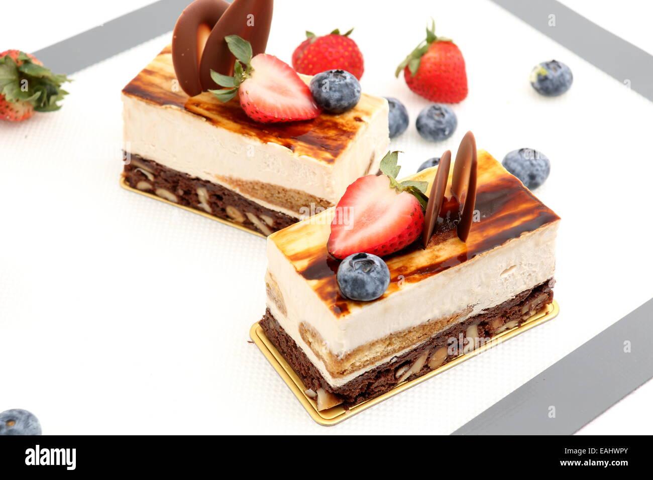brownie tiramisu cake white fresh strawberry on mat Stock Photo