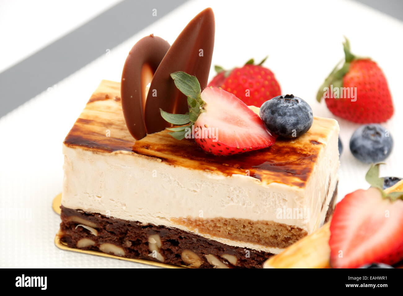 brownie tiramisu cake white fresh strawberry on mat - Stock Image