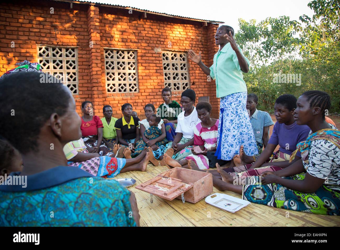 Women participate in a Village Savings and Loan meeting in Namasalima village, Mulanje District, Malawi. - Stock Image