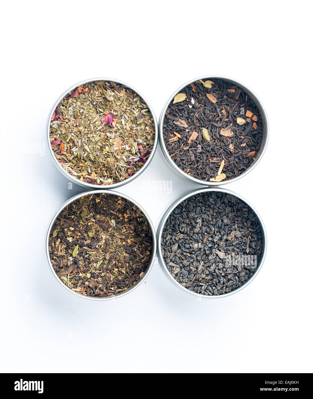 Dried tea in tins - Stock Image
