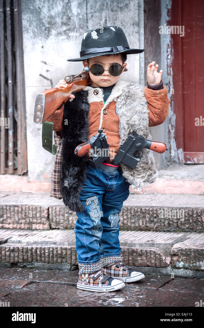Cute kid dressed as a gangster in Fenghung ancient town, Hunan Province, China - Stock Image