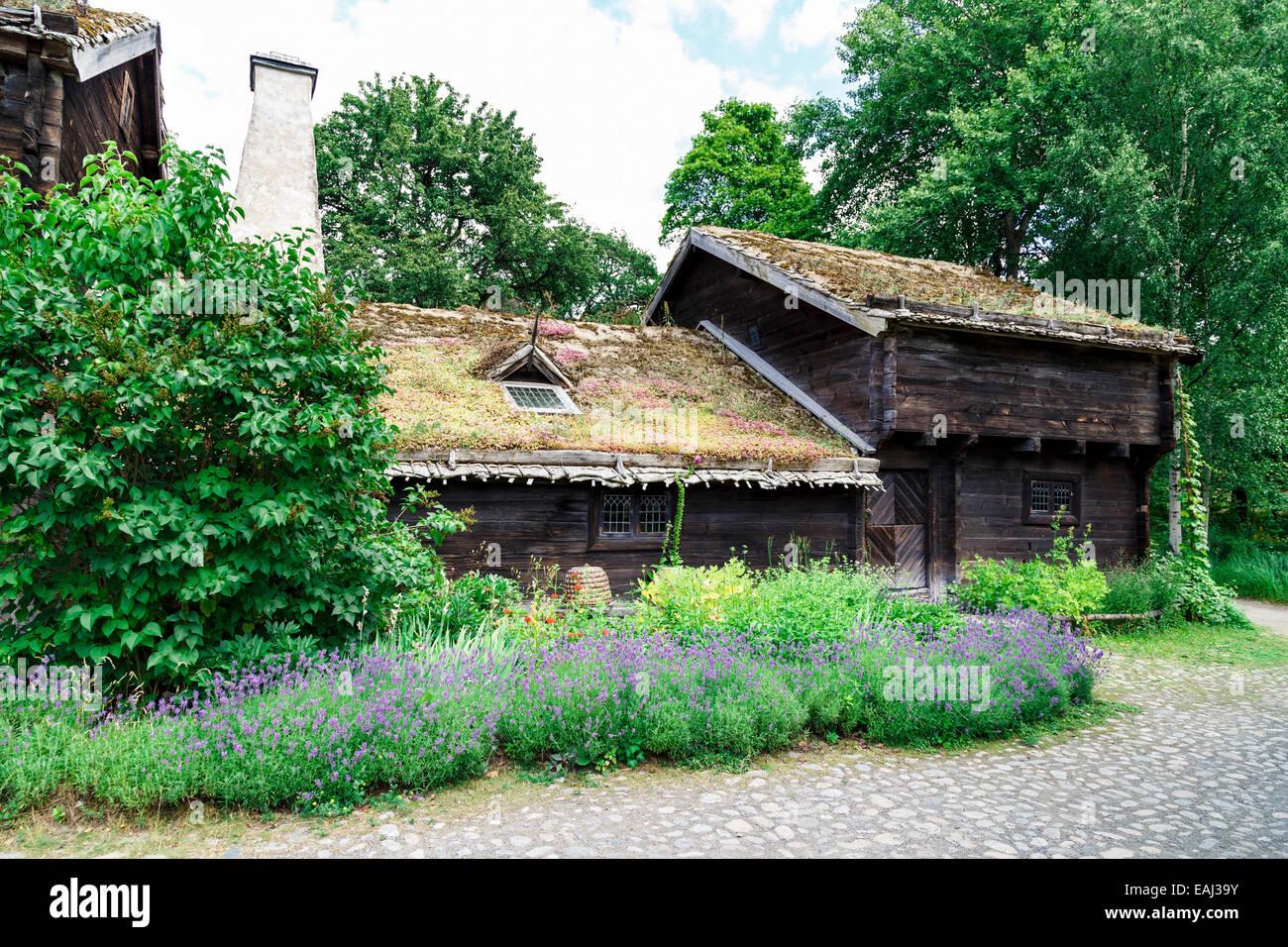 Traditional swedish farmhouse with flowering garden at Skansen, Stockholm, Sweden - Stock Image