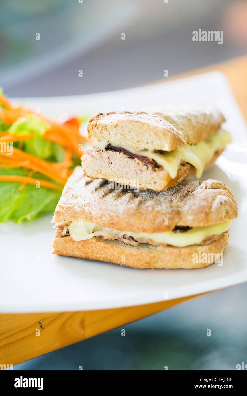 vegetarian tuna and cheese toasted baguette sandwich with side salad - Stock Image