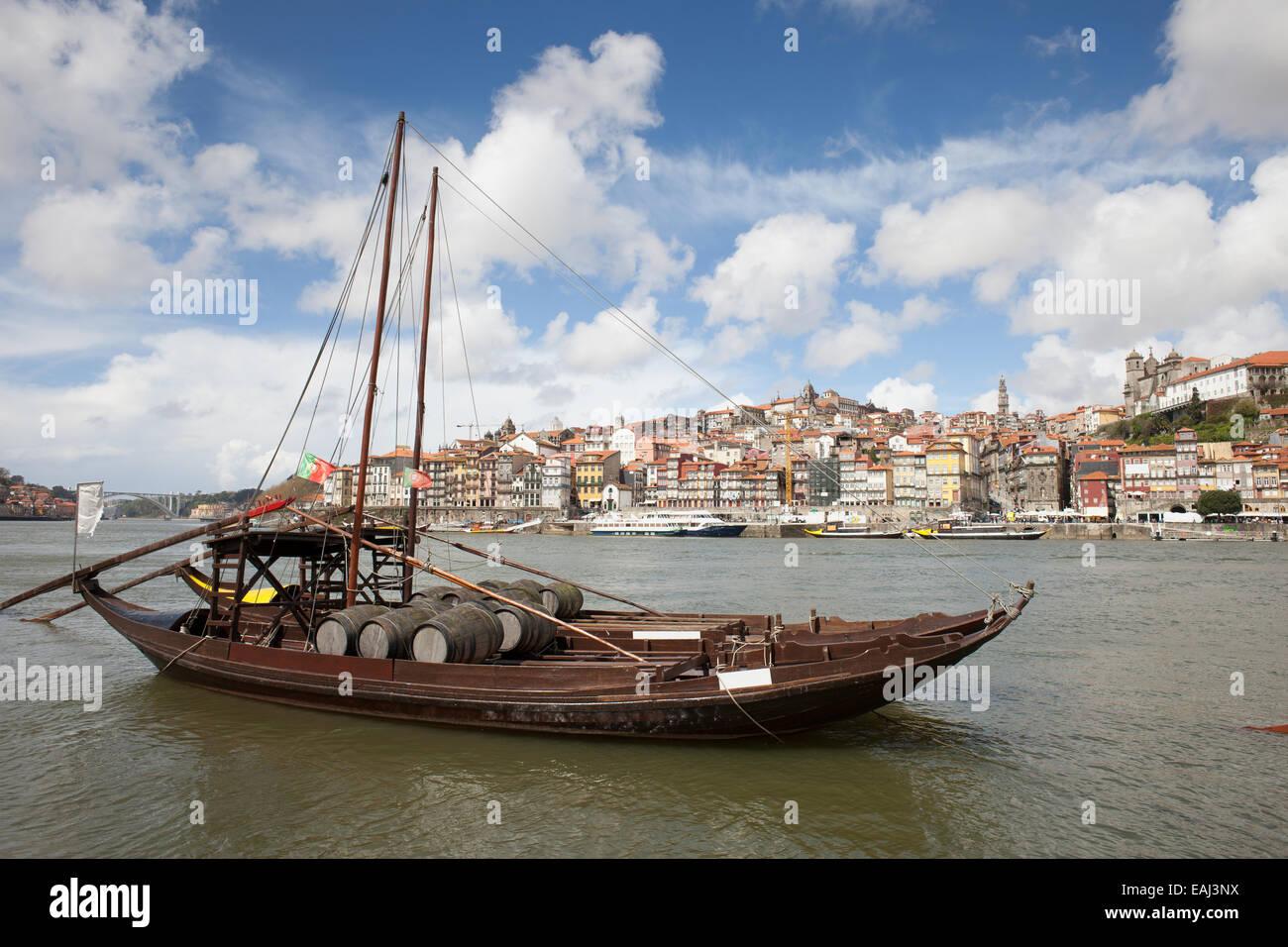 City of Porto in Portugal. Rabelo traditional Portuguese cargo boat with Port wine barrels on Douro river. Stock Photo
