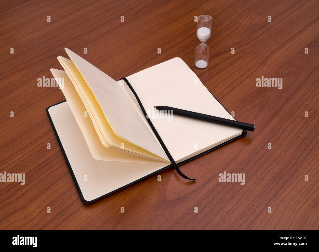No inspiration.... Notebook, pen and timer, Writers block. - Stock Image