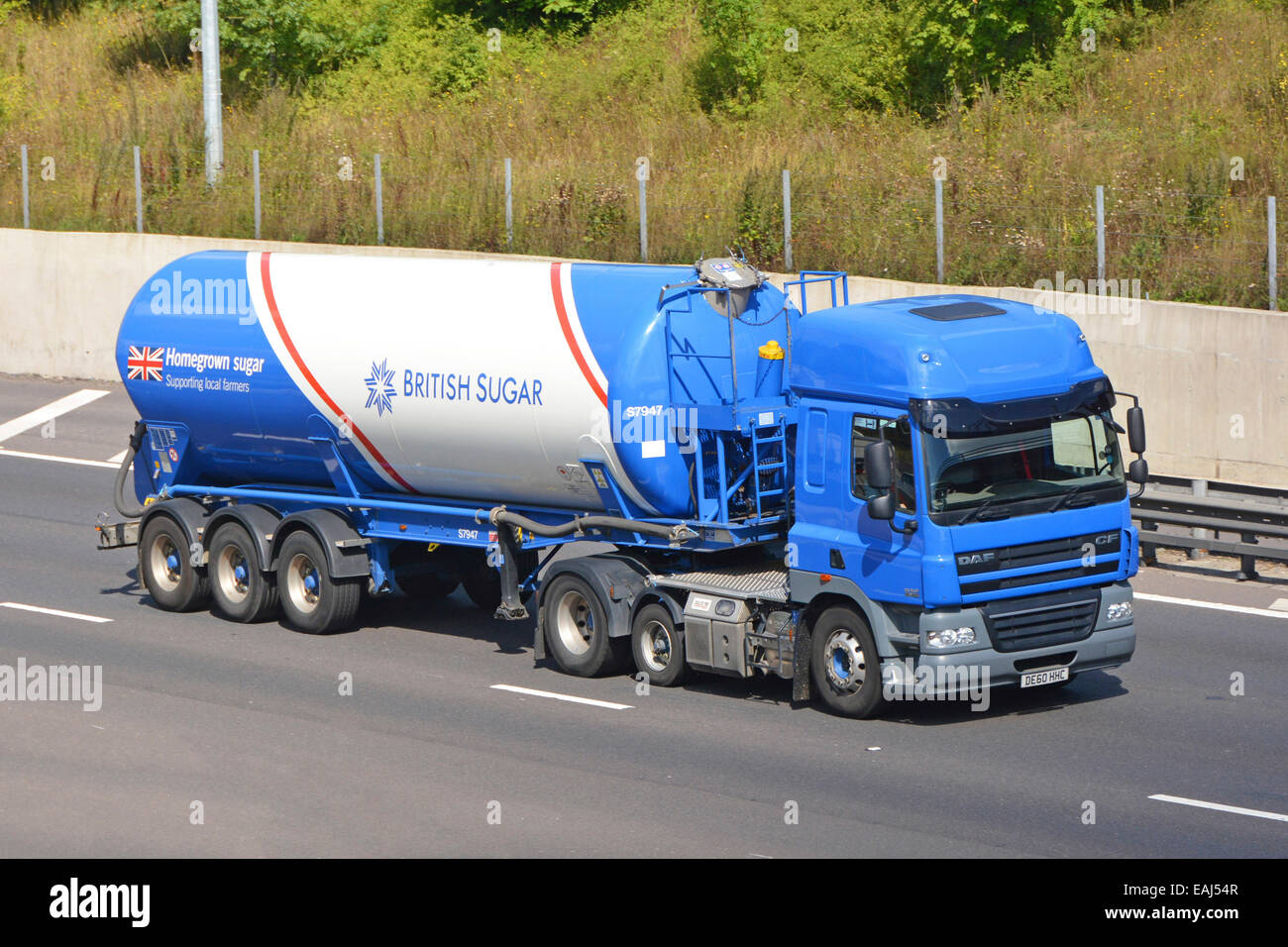 British sugar beet articulated tanker trailer and lorry driving along motorway (brand owned by Associated British - Stock Image