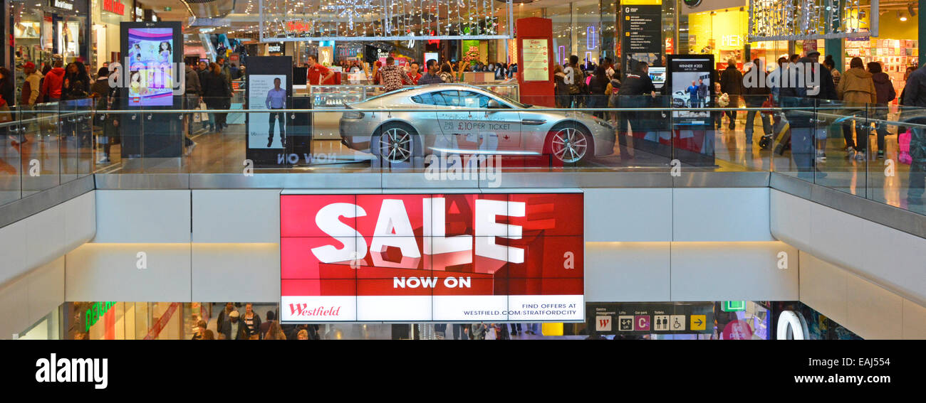 Interior view of Westfield shopping malls at January sale time with some Christmas decorations still in place - Stock Image