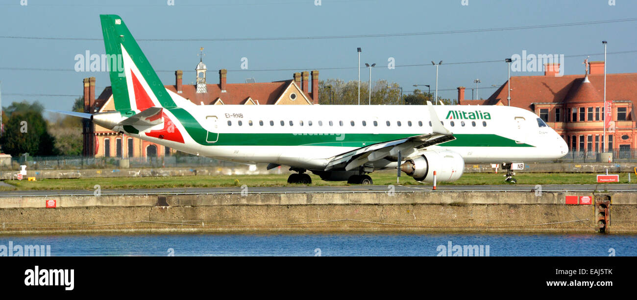 Alitalia Embraer CityLiner EI-RNB jet airliner landing at London City Airport - Stock Image