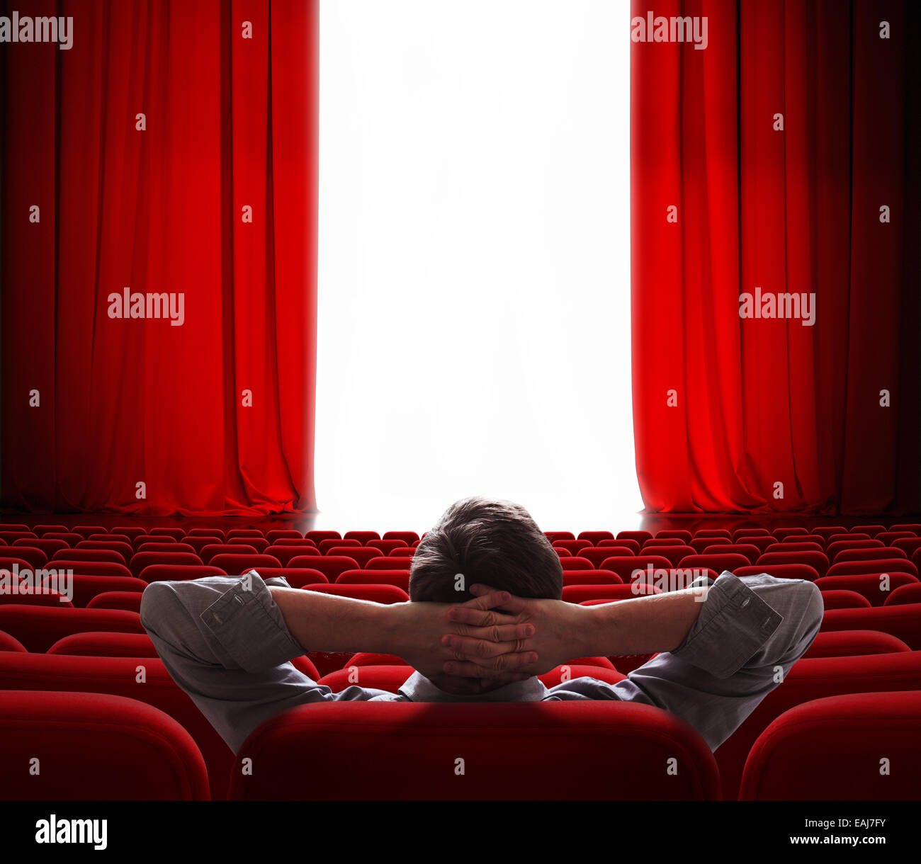 cinema screen red curtains opening for vip person - Stock Image