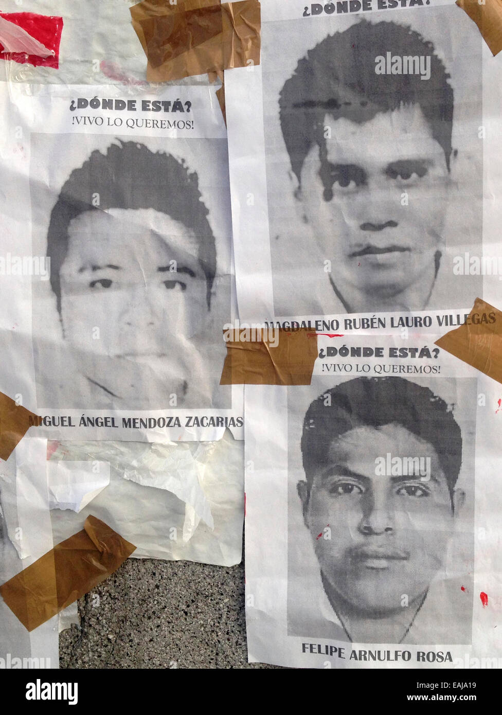 Guerrero State, Mexico. 15th Nov, 2014. Portraits of missing students Jorge Alvarez Nava painted with red paint Stock Photo