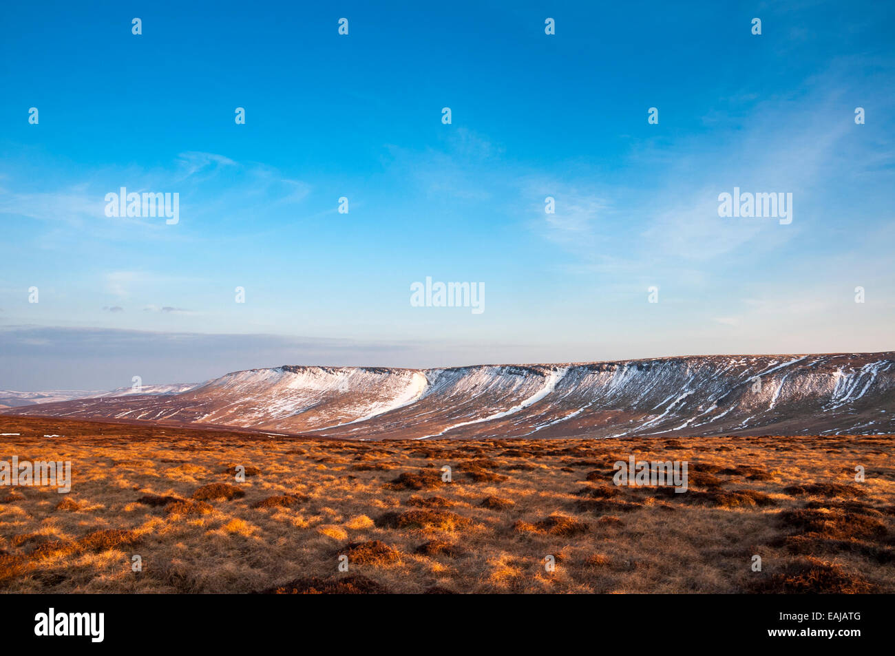 Wide open moorland near the Pennine way above Glossop in Derbyshire. Remains of late snow on the Northern edge of - Stock Image