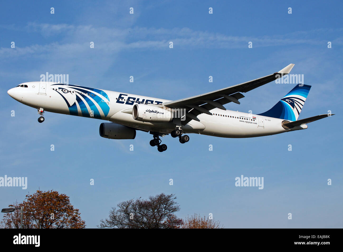 Egyptair Airbus A330-300 approaches runway 27L at London Heathrow Airport. - Stock Image