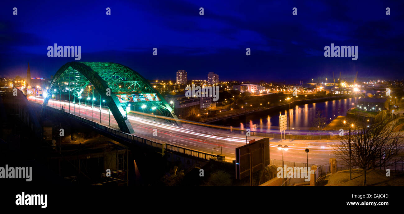 A panorama of the Wearmouth Bridge looking down the River Wear to the docks in Sunderland UK - Stock Image
