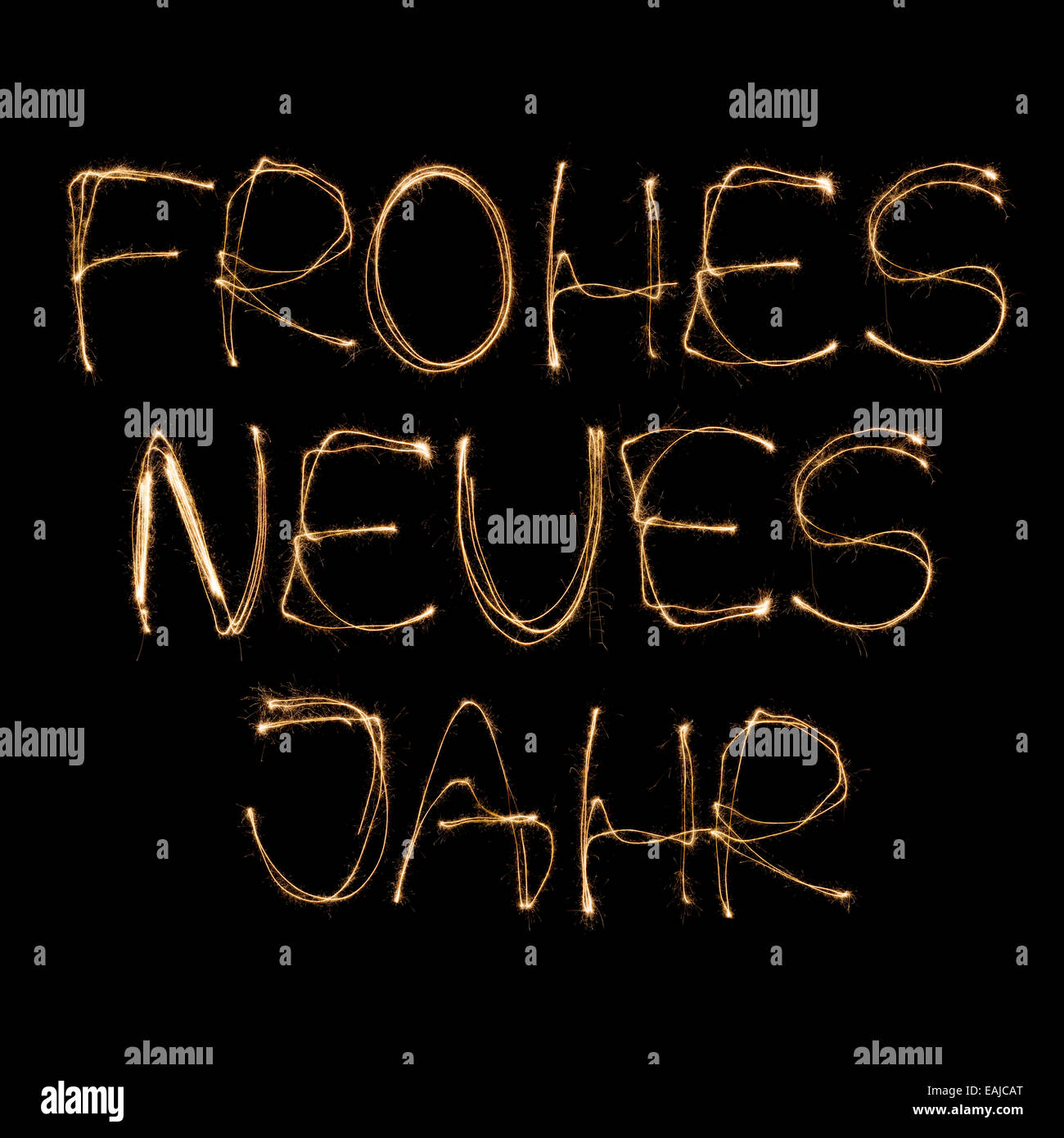 frohes neues jahr german happy new year written with a sparkler isolated on black background