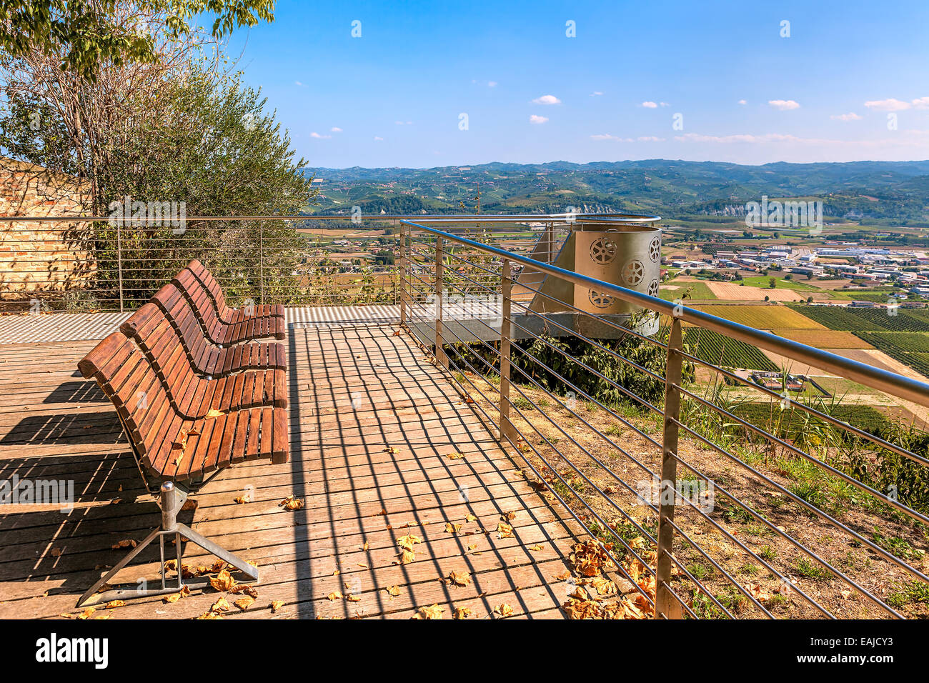 Wooden benches and beautiful viewpoint in autumn in Piedmont, Northern Italy. - Stock Image