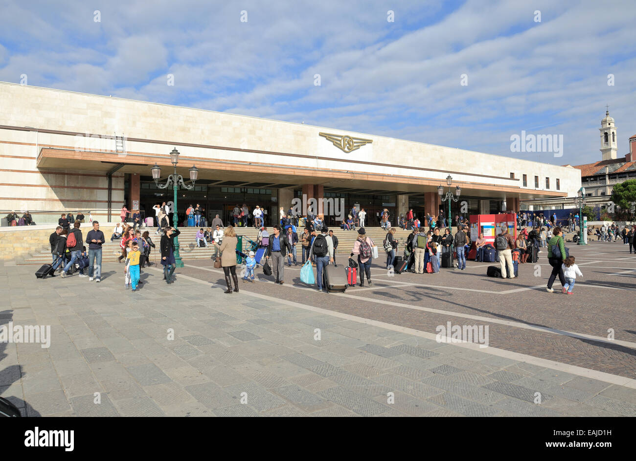 Travellers outside Santa Lucia Railway Station, Venice, Italy. - Stock Image