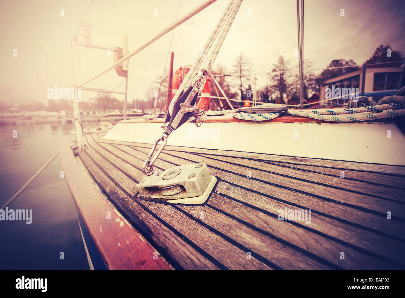Vintage filtered close up picture of yacht rigging. - Stock Image